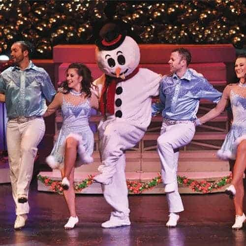 special guests frosty the snowman dacing with the country tonite cast in their pigeon forge christmas show - A Country Christmas Cast