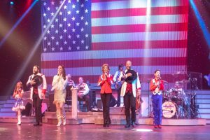 country tonite cast in front of american flag